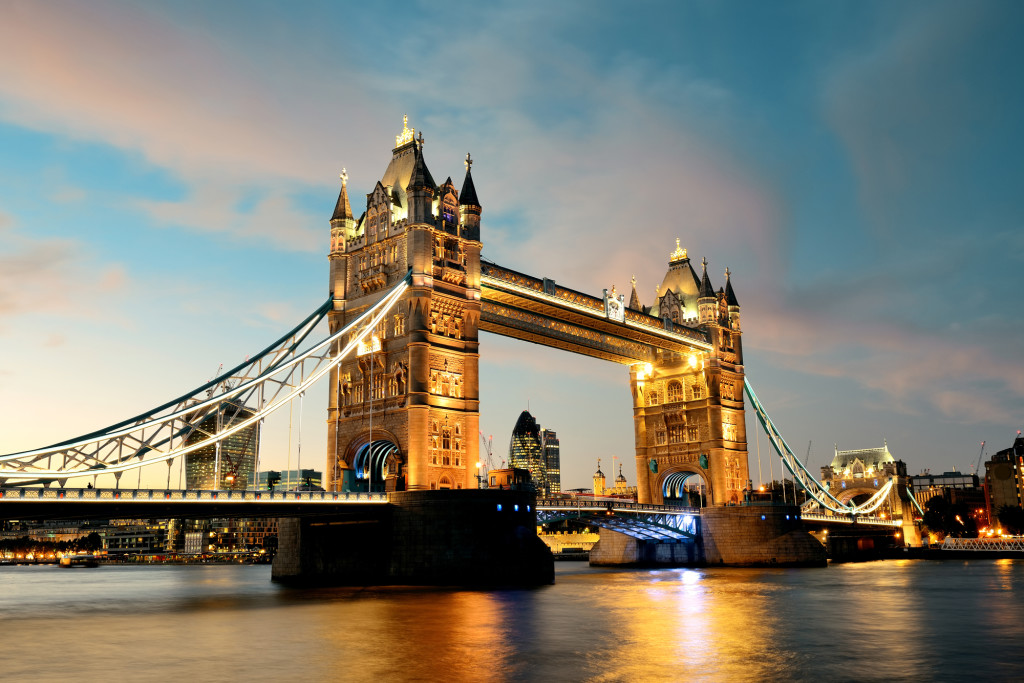 Tower Bridge over Thames River at dusk in London